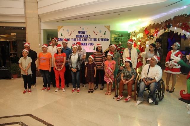 residents-of-bukit-harapan-singing-christmas-carol